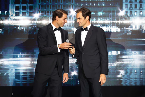 GENEVA, SWITZERLAND - SEPTEMBER 19: Rafael Nadal of Team Europe hands the microphone to teammate Roger Federer during the Laver Cup Gala at HEAD Geneve ahead of the Laver Cup 2019 at Palexpo on September 19, 2019 in Geneva, Switzerland. The Laver Cup will see six players from the rest of the World competing against their counterparts from Europe. Team World is captained by John McEnroe and Team Europe is captained by Bjorn Borg. The tournament runs from September 20-22. (Photo by Clive Brunskill/Getty Images for Laver Cup)