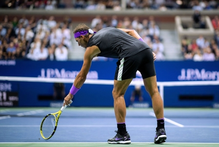 Rafael Nadal of Spain reacts to a bug before he serves against Diego Schwartzman of Argentina during their men's Singles Quarterfinals match at the 2019 US Open at the USTA Billie Jean King National Tennis Center in New York on September 4, 2019. (Photo by Johannes EISELE / AFP) (Photo credit should read JOHANNES EISELE/AFP/Getty Images)