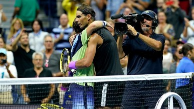 September 4, 2019 - Rafael Nadal and Diego Schwartzman hug after their quarterfinal match at the 2019 US Open. (Photo by Darren Carroll/USTA)