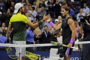 Matteo Berrettini, of Italy, left, congratulates Rafael Nadal, of Spain, after Nadal won their men's singles semifinal of the U.S. Open tennis championships Friday, Sept. 6, 2019, in New York. (AP Photo/Charles Krupa)