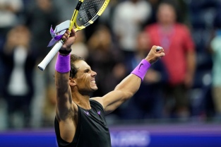 Rafael Nadal, of Spain, celebrates after defeating Matteo Berrettini, of Italy, in the men's singles semifinals of the U.S. Open tennis championships Friday, Sept. 6, 2019, in New York. (AP Photo/Eduardo Munoz Alvarez)