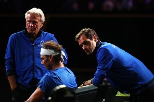 GENEVA, SWITZERLAND - SEPTEMBER 21: Roger Federer of Team Europe speaks to teammate Rafael Nadal as he sits down in his singles match against Milos Raonic of Team World during Day Two of the Laver Cup 2019 at Palexpo on September 21, 2019 in Geneva, Switzerland. The Laver Cup will see six players from the rest of the World competing against their counterparts from Europe. Team World is captained by John McEnroe and Team Europe is captained by Bjorn Borg. The tournament runs from September 20-22. (Photo by Julian Finney/Getty Images for Laver Cup)