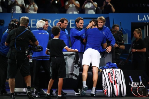 GENEVA, SWITZERLAND - SEPTEMBER 20: Dominic Thiem of Team Europe celebrates with teammate Roger Federer following his victory against Denis Shapovalov of Team World during Day One of the Laver Cup 2019 at Palexpo on September 20, 2019 in Geneva, Switzerland. The Laver Cup will see six players from the rest of the World competing against their counterparts from Europe. Team World is captained by John McEnroe and Team Europe is captained by Bjorn Borg. The tournament runs from September 20-22. (Photo by Julian Finney/Getty Images for Laver Cup)