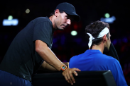 GENEVA, SWITZERLAND - SEPTEMBER 22: Rafael Nadal of Team Europe speaks to teammate Roger Federer as he sits down in his singles match against John Isner of Team World during Day Three of the Laver Cup 2019 at Palexpo on September 22, 2019 in Geneva, Switzerland. The Laver Cup will see six players from the rest of the World competing against their counterparts from Europe. Team World is captained by John McEnroe and Team Europe is captained by Bjorn Borg. The tournament runs from September 20-22. (Photo by Julian Finney/Getty Images for Laver Cup)