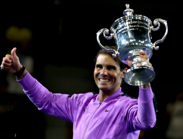 NEW YORK, NEW YORK - SEPTEMBER 08: Rafael Nadal of Spain celebrates with the championship trophy during the trophy presentation ceremony after winning his Men's Singles final match against Daniil Medvedev of Russia on day fourteen of the 2019 US Open at the USTA Billie Jean King National Tennis Center on September 08, 2019 in the Queens borough of New York City. (Photo by Al Bello/Getty Images)