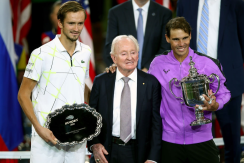 NEW YORK, NEW YORK - SEPTEMBER 08: Rafael Nadal (R) of Spain celebrates with the championship trophy alongside finalist Daniil Medvedev (L) of Russia and tennis champion Rod Laver (C) during the trophy presentation ceremony after their Men's Singles final match on day fourteen of the 2019 US Open at the USTA Billie Jean King National Tennis Center on September 08, 2019 in the Queens borough of New York City. (Photo by Clive Brunskill/Getty Images)