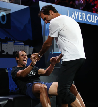 GENEVA, SWITZERLAND - SEPTEMBER 22: Roger Federer of Switzerland and Rafael Nadal of Spain celebrate the win by Alexander Zverev of Team Europe over Milos Raonic of Team World during Day Three of the Laver Cup 2019 at Palexpo on September 22, 2019 in Geneva, Switzerland. The Laver Cup will see six players from the rest of the World competing against their counterparts from Europe. Team World is captained by John McEnroe and Team Europe is captained by Bjorn Borg. The tournament runs from September 20-22. (Photo by Julian Finney/Getty Images for Laver Cup)