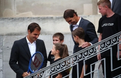 Tennis - Official welcome of Laver Cup teams - Geneva, Switzerland - September 18, 2019 Team Europe's Roger Federer and Rafael Nadal talk to children during the official welcome REUTERS/Denis Balibouse