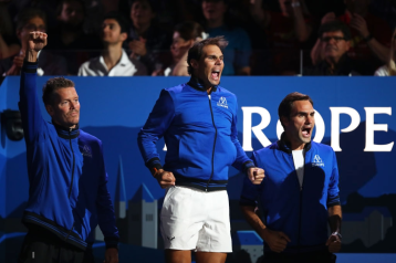 GENEVA, SWITZERLAND - SEPTEMBER 20: Thomas Enqvist, Vice Captain of Team Europe, Rafael Nadal and Roger Federer of Team Europe celebrate as they watch the singles match between Denis Shapovalov of Team World and Dominic Thiem of Team Europe during Day One of the Laver Cup 2019 at Palexpo on September 20, 2019 in Geneva, Switzerland. The Laver Cup will see six players from the rest of the World competing against their counterparts from Europe. Team World is captained by John McEnroe and Team Europe is captained by Bjorn Borg. The tournament runs from September 20-22. (Photo by Julian Finney/Getty Images for Laver Cup)