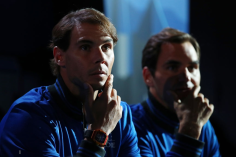 GENEVA, SWITZERLAND - SEPTEMBER 20: Rafael Nadal and Roger Federer of Team Europe look on from court-side during Day One of the Laver Cup 2019 at Palexpo on September 20, 2019 in Geneva, Switzerland. The Laver Cup will see six players from the rest of the World competing against their counterparts from Europe. Team World is captained by John McEnroe and Team Europe is captained by Bjorn Borg. The tournament runs from September 20-22. (Photo by Clive Brunskill/Getty Images for Laver Cup)
