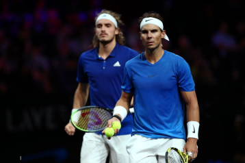 GENEVA, SWITZERLAND - SEPTEMBER 21: Rafael Nadal of Team Europe and playing partner Stefanos Tsitsipas look on in their doubles match against Jack Sock and Nick Kyrgios of Team World during Day Two of the Laver Cup 2019 at Palexpo on September 21, 2019 in Geneva, Switzerland. The Laver Cup will see six players from the rest of the World competing against their counterparts from Europe. Team World is captained by John McEnroe and Team Europe is captained by Bjorn Borg. The tournament runs from September 20-22. (Photo by Clive Brunskill/Getty Images for Laver Cup)