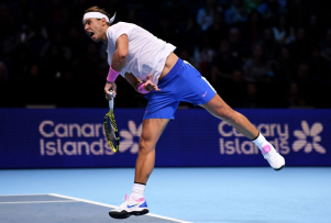 LONDON, ENGLAND - NOVEMBER 13: Rafael Nadal of Spain serves in his singles match against Daniil Medvedev of Russia during Day Four of the Nitto ATP World Tour Finals at The O2 Arena on November 13, 2019 in London, England. (Photo by Justin Setterfield/Getty Images)