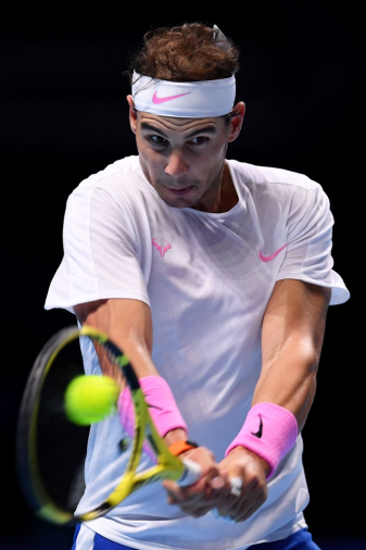 LONDON, ENGLAND - NOVEMBER 13: Rafael Nadal of Spain plays a backhand in his singles match against Daniil Medvedev of Russia during Day Four of the Nitto ATP World Tour Finals at The O2 Arena on November 13, 2019 in London, England. (Photo by Justin Setterfield/Getty Images)