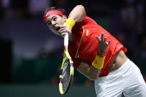 MADRID, SPAIN - NOVEMBER 24: Rafael Nadal of Spain plays a serve in his singles final match against Denis Shapovalov of Canada during Day Seven of the 2019 Davis Cup at La Caja Magica on November 24, 2019 in Madrid, Spain. (Photo by Alex Pantling/Getty Images)