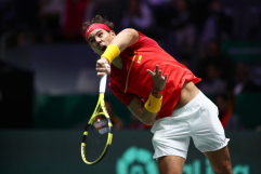 MADRID, SPAIN - NOVEMBER 24: Rafael Nadal of Spain plays a serve in his singles final match against Denis Shapovalov of Canada during Day Seven of the 2019 Davis Cup at La Caja Magica on November 24, 2019 in Madrid, Spain. (Photo by Clive Brunskill/Getty Images)
