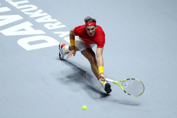 MADRID, SPAIN - NOVEMBER 24: Rafael Nadal of Spain stretches to play a forehand in his singles final match against Denis Shapovalov of Canada during Day Seven of the 2019 Davis Cup at La Caja Magica on November 24, 2019 in Madrid, Spain. (Photo by Clive Brunskill/Getty Images)