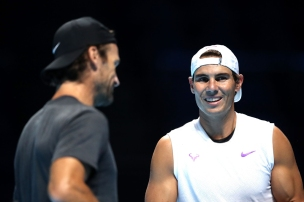 LONDON, ENGLAND - NOVEMBER 08: Carlos Moya chats with Rafael Nadal of Spain in a practice session during previews for the Nitto ATP World Tour Finals at The O2 Arena on November 08, 2019 in London, England. (Photo by Alex Pantling/Getty Images)