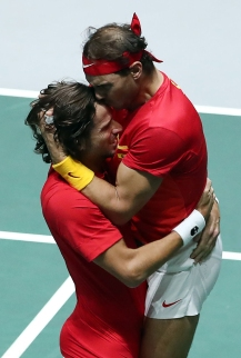 Spain's Rafael Nadal (R) and Spain's Feliciano Lopez celebrate after defeating Great Britain's Jamie Murray and Great Britain's Neal Skupski during the semi-final doubles tennis match between Great Britain and Spain at the Davis Cup Madrid Finals 2019 in Madrid on November 23, 2019. (Photo by Oscar DEL POZO / AFP) (Photo by OSCAR DEL POZO/AFP via Getty Images)