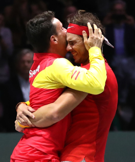 MADRID, SPAIN - NOVEMBER 24: Rafael Nadal of Spain celebrates match point with Roberto Bautista Agut in his singles match against Denis Shapovalov of Canada in the Final between Spain and Canada during Day Seven of the 2019 David Cup at La Caja Magica on November 24, 2019 in Madrid, Spain. (Photo by Alex Pantling/Getty Images)