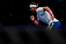 Spain's Rafael Nadal runs to return against Russia's Daniil Medvedev during their men's singles round-robin match on day four of the ATP World Tour Finals tennis tournament at the O2 Arena in London on November 13, 2019. (Photo by Adrian DENNIS / AFP) (Photo by ADRIAN DENNIS/AFP via Getty Images)