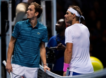 LONDON, ENGLAND - NOVEMBER 13: Rafael Nadal of Spain and Daniil Medvedev of Russia wait for a Hawkeye review of a challenged line call on match point of their match during Day Four of the Nitto ATP World Tour Finals at The O2 Arena on November 13, 2019 in London, England. (Photo by TPN/Getty Images)