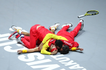 MADRID, SPAIN - NOVEMBER 24: Rafael Nadal of Spain celebrates match point with his team mates following his singles final match against Denis Shapovalov of Canada which leads Spain to victory during Day Seven of the 2019 Davis Cup at La Caja Magica on November 24, 2019 in Madrid, Spain. (Photo by Clive Brunskill/Getty Images)