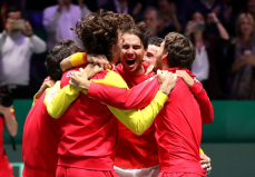 MADRID, SPAIN - NOVEMBER 24: Rafael Nadal of Spain celebrates victory with team mates following his singles match against Denis Shapovalov of Canada in the Final between Spain and Canada during Day Seven of the 2019 David Cup at La Caja Magica on November 24, 2019 in Madrid, Spain. (Photo by Alex Pantling/Getty Images)