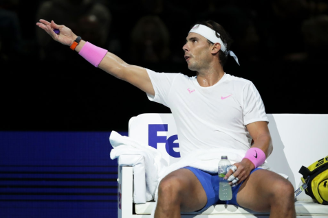 LONDON, ENGLAND - NOVEMBER 11: Rafael Nadal of Spain reacts as he sits down during a change of ends in his singles match against Alexander Zverev of Germany during Day Two of the Nitto ATP World Tour Finals at The O2 Arena on November 11, 2019 in London, England. (Photo by Julian Finney/Getty Images)