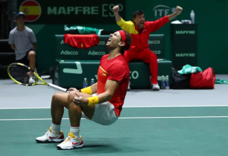 MADRID, SPAIN - NOVEMBER 23: Rafael Nadal of Spain, playing partner of Feliciano Lopez of Spain celebrate match point in their semi-final doubles match against Jamie Murray and Neal Skupski of Great Britain during Day 6 of the 2019 Davis Cup at La Caja Magica on November 23, 2019 in Madrid, Spain. (Photo by Clive Brunskill/Getty Images for LTA)