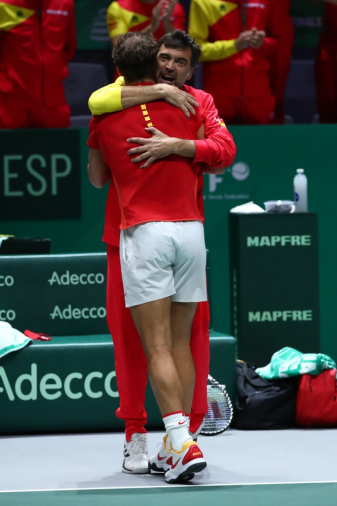 MADRID, SPAIN - NOVEMBER 23: Rafael Nadal of Spain, playing partner of Feliciano Lopez celebrates with captain Sergi Bruguera of Spain following their victory in the semi-final doubles match against Jamie Murray and Neal Skupski of Great Britain during Day 6 of the 2019 Davis Cup at La Caja Magica on November 23, 2019 in Madrid, Spain. (Photo by Clive Brunskill/Getty Images for LTA)