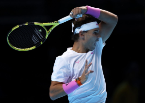 LONDON, ENGLAND - NOVEMBER 15: Rafael Nadal of Spain plays a forehand in his singles match against Stefanos Tsitsipas of Greece during Day Six of the Nitto ATP World Tour Finals at The O2 Arena on November 15, 2019 in London, England. (Photo by Julian Finney/Getty Images)