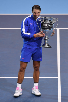 LONDON, ENGLAND - NOVEMBER 15: Rafael Nadal of Spain poses with his trophy after being announced as ATP Tour end of year world number one following his singles match against Stefanos Tsitsipas of Greece during Day Six of the Nitto ATP World Tour Finals at The O2 Arena on November 15, 2019 in London, England. (Photo by Justin Setterfield/Getty Images)