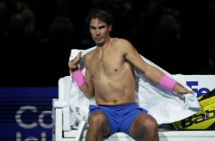 LONDON, ENGLAND - NOVEMBER 11: Rafael Nadal of Spain drys himself with a towel as he sits down during a change of ends in his singles match against Alexander Zverev of Germany during Day Two of the Nitto ATP World Tour Finals at The O2 Arena on November 11, 2019 in London, England. (Photo by Julian Finney/Getty Images)
